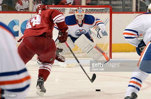 Ben Scrivens of the Edmonton Oilers gets ready to make a save against the Arizona Coyotes at Gila River Arena on October 15 2014 in Glendale Arizona