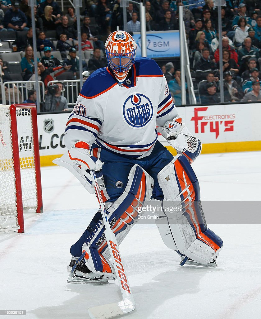 Ben Scrivens of the Edmonton Oilers handles the puck against the San Jose Sharks during an NHL game on April 1 2014 at SAP Center in San Jose...