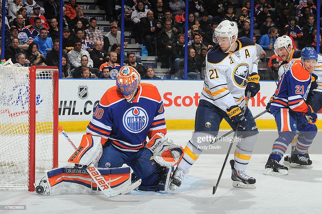 Ben Scrivens #30 of the Edmonton Oilers makes a save on a shot from Drew Stafford #21 of the Buffalo Sabres on March 20, 2014 at Rexall Place in Edmonton, Alberta, Canada.