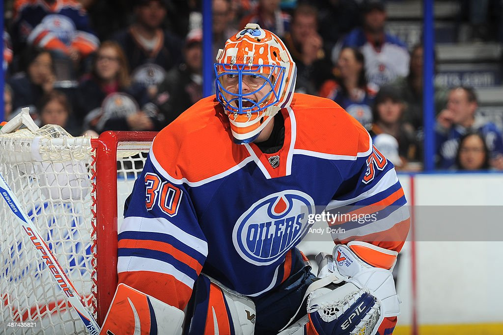 Ben Scrivens of the Edmonton Oilers prepares to make a save in a game against the Vancouver Canucks on April 12 2014 at Rexall Place in Edmonton...