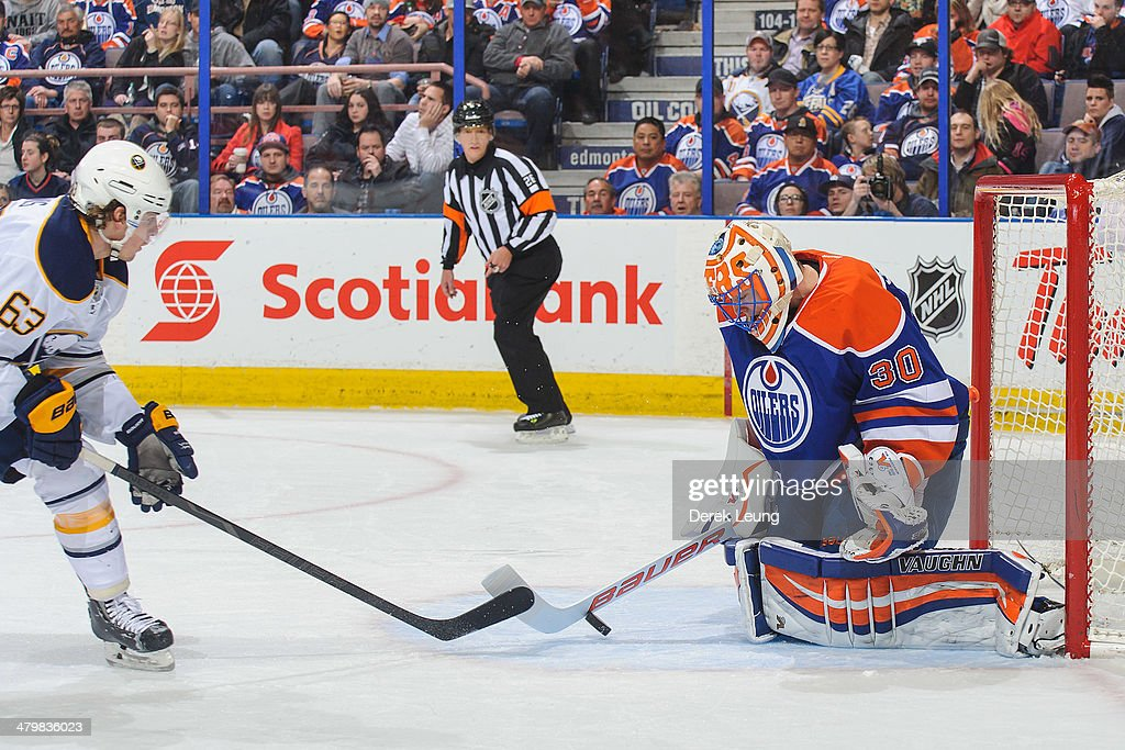 Ben Scrivens #30 of the Edmonton Oilers stops the shot of Tyler Ennis #63 of the Buffalo Sabres during an NHL game at Rexall Place on March 20, 2014 in Edmonton, Alberta, Canada. The Sabres defeated the Oilers 3-1.
