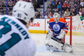 Ben Scrivens of the Edmonton Oilers stops the shot of Tyler Kennedy of the San Jose Sharks during an NHL game at Rexall Place on January 29 2014 in...