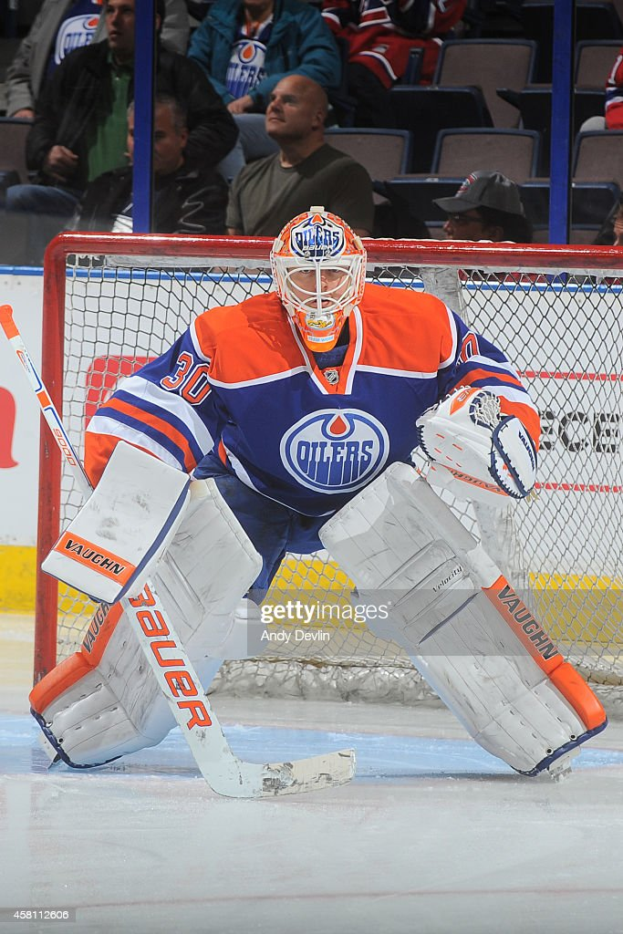 Ben Scrivens of the Edmonton Oilers warms up prior to a game against the Montreal Canadiens on October 27 2014 at Rexall Place in Edmonton Alberta...