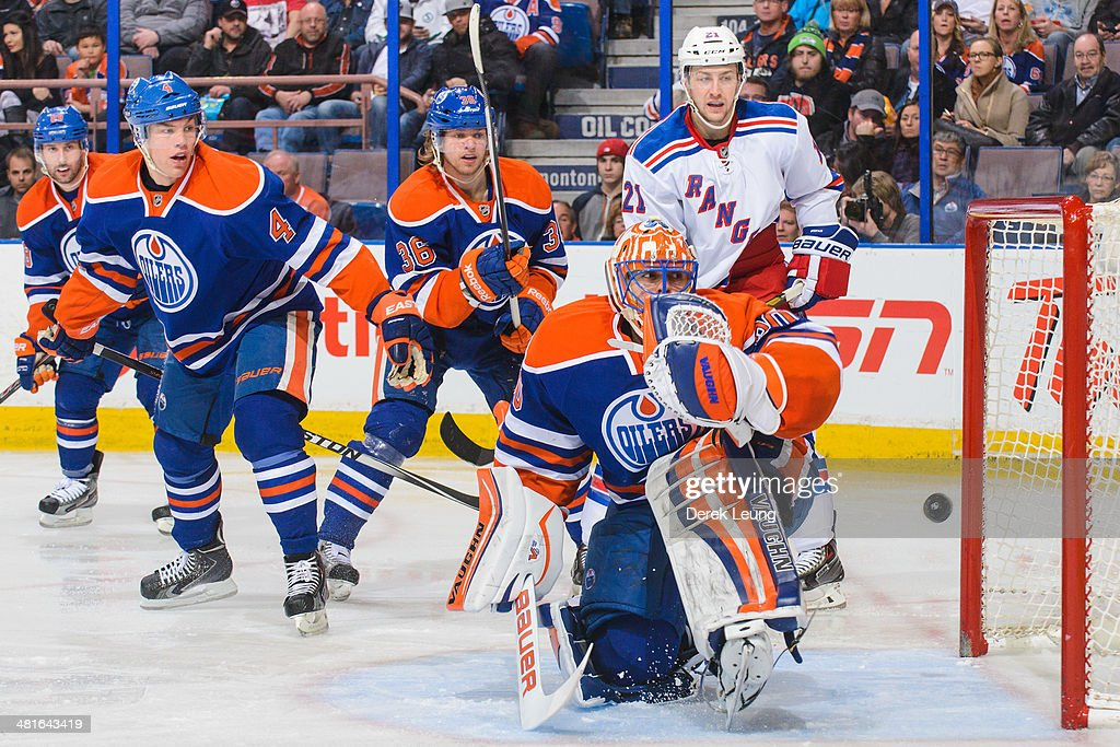 Ben Scrivens of the Edmonton Oilers watches the shot of Mats Zuccarello of the New York Rangers fly past him during an NHL game at Rexall Place on...