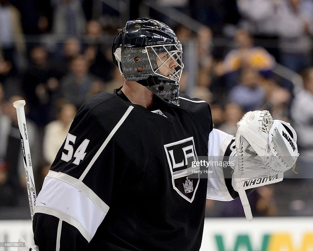 Ben Scrivens #54 of the Los Angeles Kings celebrates a 5-2 win over the Tampa Bay Lightning at Staples Center on November 19, 2013 in Los Angeles, California.