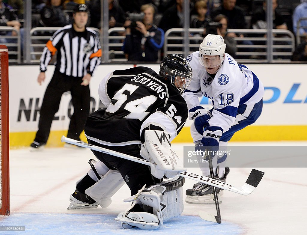 Ben Scrivens #54 of the Los Angeles Kings stops Ondrej Palat #18 of the Tampa Bay Lightning during the third period at Staples Center on November 19, 2013 in Los Angeles, California.