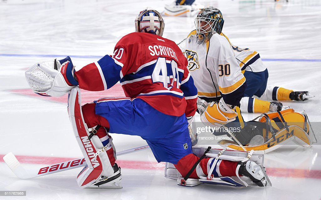 Ben Scrivens of the Montreal Canadiens and Carter Hutton of the Nashville Predators exchanges words before the NHL game at the Bell Centre on...