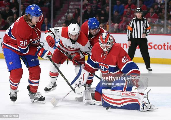 Ben Scrivens of the Montreal Canadiens blocks the shot by the Carolina Hurricanes in the NHL game at the Bell Centre on February 7 2016 in Montreal...