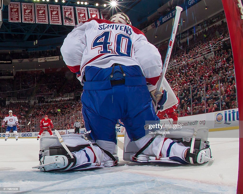 Ben Scrivens of the Montreal Canadiens makes a save against the Detroit Red Wings during an NHL game at Joe Louis Arena on March 24 2016 in Detroit...