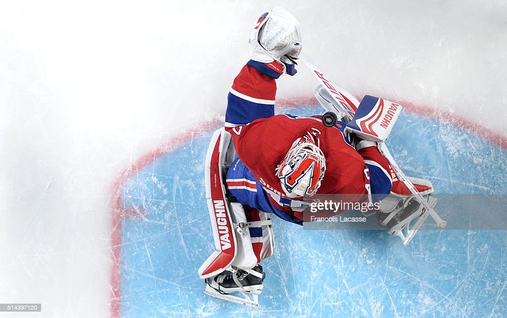 Ben Scrivens of the Montreal Canadiens stops a shot by the Dallas Stars in the NHL game at the Bell Centre on March 8 2016 in Montreal Quebec Canada