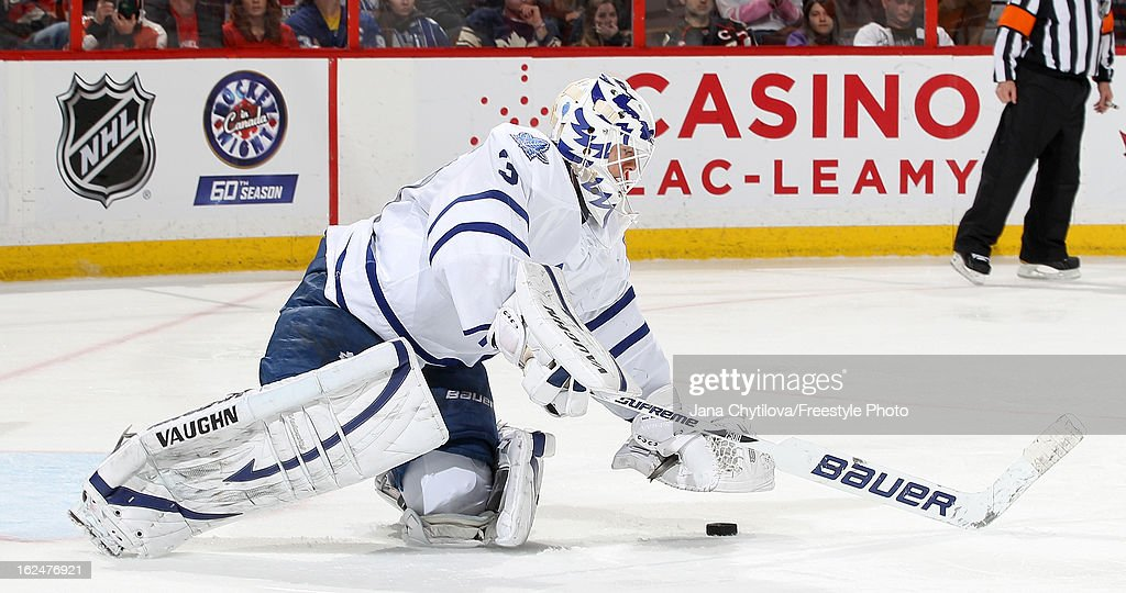 <a gi-track='captionPersonalityLinkClicked' href=/galleries/search?phrase=Ben+Scrivens&family=editorial&specificpeople=7185205 ng-click='$event.stopPropagation()'>Ben Scrivens</a> #30 of the Toronto Maple Leafs covers the puck, during an NHL game against the Ottawa Senators, at Scotiabank Place on February 23, 2013 in Ottawa, Ontario, Canada.