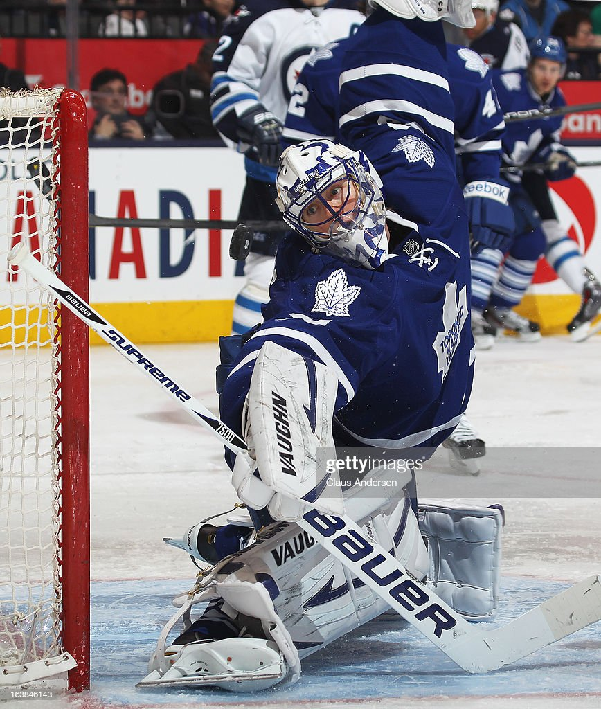 <a gi-track='captionPersonalityLinkClicked' href=/galleries/search?phrase=Ben+Scrivens&family=editorial&specificpeople=7185205 ng-click='$event.stopPropagation()'>Ben Scrivens</a> #30 of the Toronto Maple Leafs gets a piece of the puck in a game against the Winnipeg Jets on March 16, 2013 at the Air Canada Centre in Toronto, Ontario, Canada. The Jets defeated the Leafs 5-4 in an overtime shoot-out.