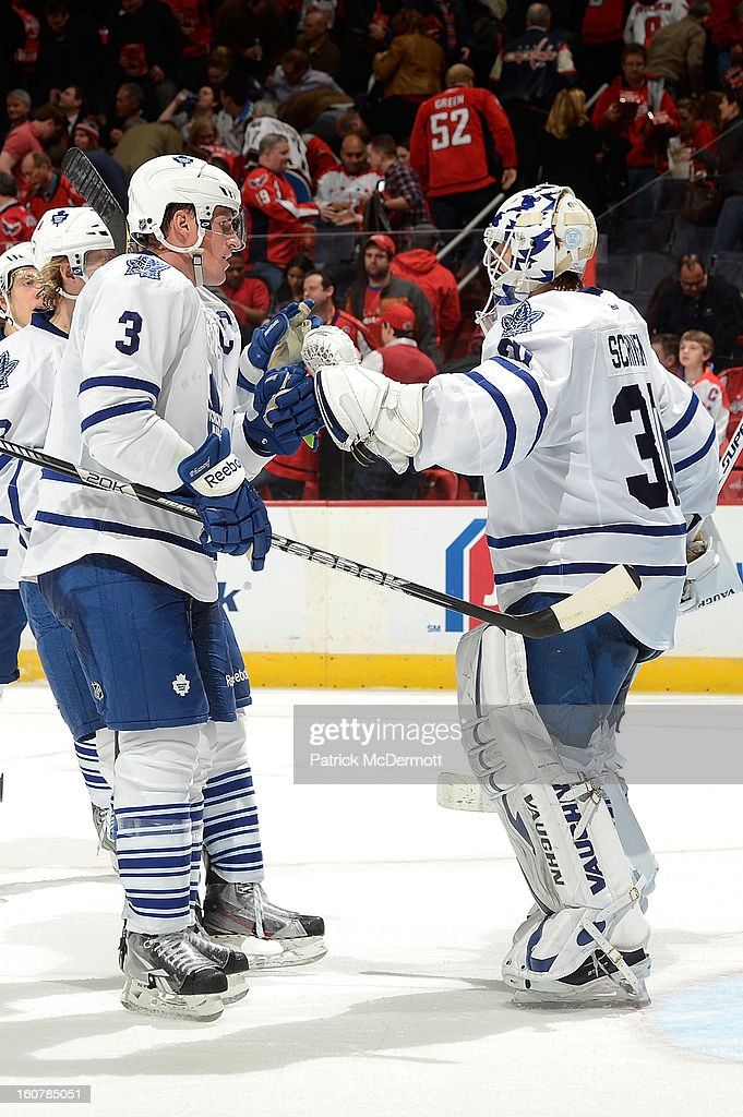 <a gi-track='captionPersonalityLinkClicked' href=/galleries/search?phrase=Ben+Scrivens&family=editorial&specificpeople=7185205 ng-click='$event.stopPropagation()'>Ben Scrivens</a> #30 of the Toronto Maple Leafs is congratulated by <a gi-track='captionPersonalityLinkClicked' href=/galleries/search?phrase=Dion+Phaneuf&family=editorial&specificpeople=545455 ng-click='$event.stopPropagation()'>Dion Phaneuf</a> #3 of the Toronto Maple Leafs after the Maple Leafs defeated the Capitals 3-2 at Verizon Center on February 5, 2013 in Washington, DC.