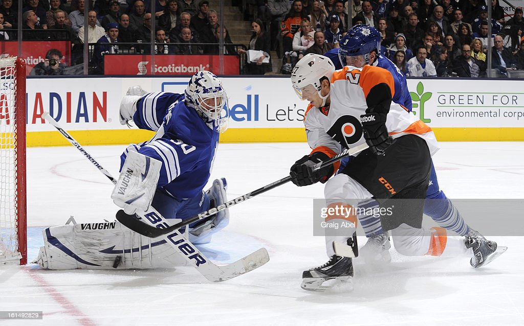 <a gi-track='captionPersonalityLinkClicked' href=/galleries/search?phrase=Ben+Scrivens&family=editorial&specificpeople=7185205 ng-click='$event.stopPropagation()'>Ben Scrivens</a> #30 of the Toronto Maple Leafs makes a pad save as teammate <a gi-track='captionPersonalityLinkClicked' href=/galleries/search?phrase=Dion+Phaneuf&family=editorial&specificpeople=545455 ng-click='$event.stopPropagation()'>Dion Phaneuf</a> #3 battles with <a gi-track='captionPersonalityLinkClicked' href=/galleries/search?phrase=Bruno+Gervais&family=editorial&specificpeople=215079 ng-click='$event.stopPropagation()'>Bruno Gervais</a> #27 of the Philadelphia Flyers during NHL game action February 11, 2013 at the Air Canada Centre in Toronto, Ontario, Canada.
