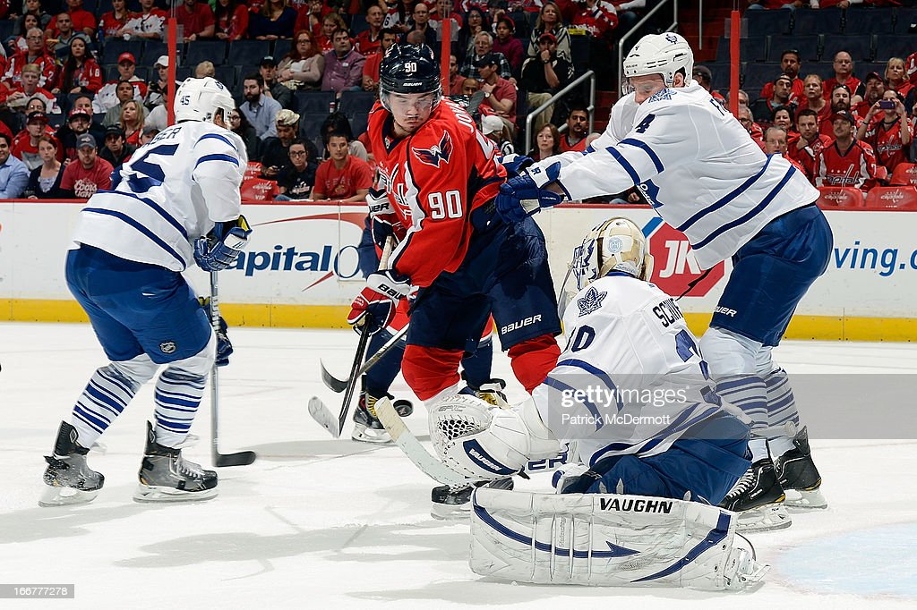 <a gi-track='captionPersonalityLinkClicked' href=/galleries/search?phrase=Ben+Scrivens&family=editorial&specificpeople=7185205 ng-click='$event.stopPropagation()'>Ben Scrivens</a> #30 of the Toronto Maple Leafs makes a save against <a gi-track='captionPersonalityLinkClicked' href=/galleries/search?phrase=Marcus+Johansson&family=editorial&specificpeople=4247883 ng-click='$event.stopPropagation()'>Marcus Johansson</a> #90 of the Washington Capitals during the first period of an NHL game at Verizon Center on April 16, 2013 in Washington, DC.