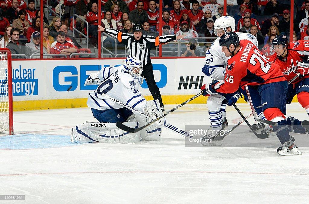 Ben Scrivens #30 of the Toronto Maple Leafs makes a save against Matt Hendricks #26 of the Washington Capitals at the Verizon Center on February 5, 2013 in Washington, DC.