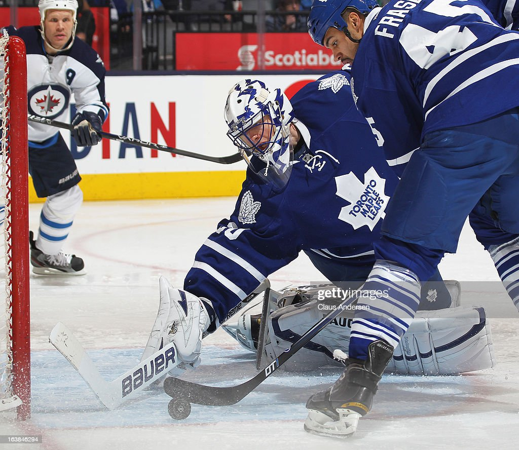<a gi-track='captionPersonalityLinkClicked' href=/galleries/search?phrase=Ben+Scrivens&family=editorial&specificpeople=7185205 ng-click='$event.stopPropagation()'>Ben Scrivens</a> #30 of the Toronto Maple Leafs makes a save in a game against the Winnipeg Jets on March 16, 2013 at the Air Canada Centre in Toronto, Ontario, Canada. The Jets defeated the Leafs 5-4 in an overtime shoot-out.