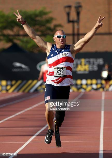 Ben Seekell of the United States celebrates after winning gold in the Men's IT1 400m Final during Day Three of the Invictus Games 2017 at York Lions...