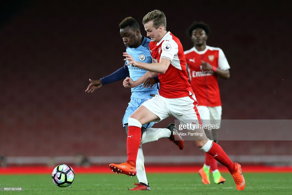 Ben Sheaf of Arsenal and Thierry Ambrose of Manchester City in action during the Premier League 2 match between Arsenal and Manchester City at Emirates Stadium on March 13, 2017 in London, England.