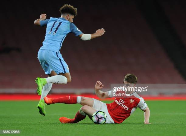 Ben Sheaf of Arsenal tackles Jadon Sancho of Man City during match between Arsenal and Manchester City at Emirates Stadium on March 13 2017 in London...