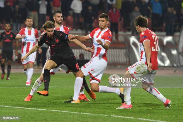 Ben Sheaf of Arsenal takes on Srdan Babic and Filip Stojkovic of Red Star during the UEFA Europa League group H match between Crvena Zvezda and...