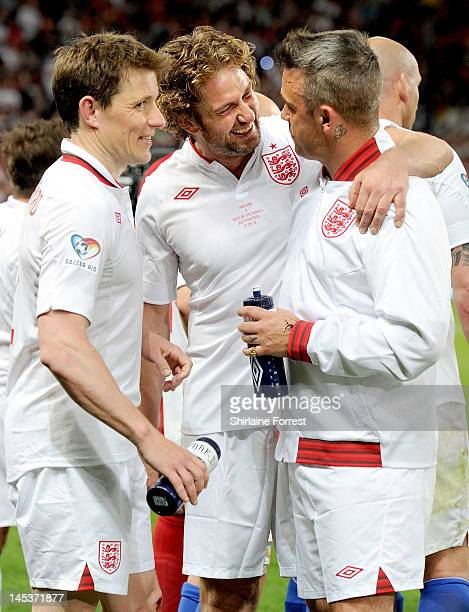 Ben Shephard Gerard Butler and Robbie Williams play in the charity football event Soccer Aid 2012 to raise funds for UNICEF on May 27 2012 in...