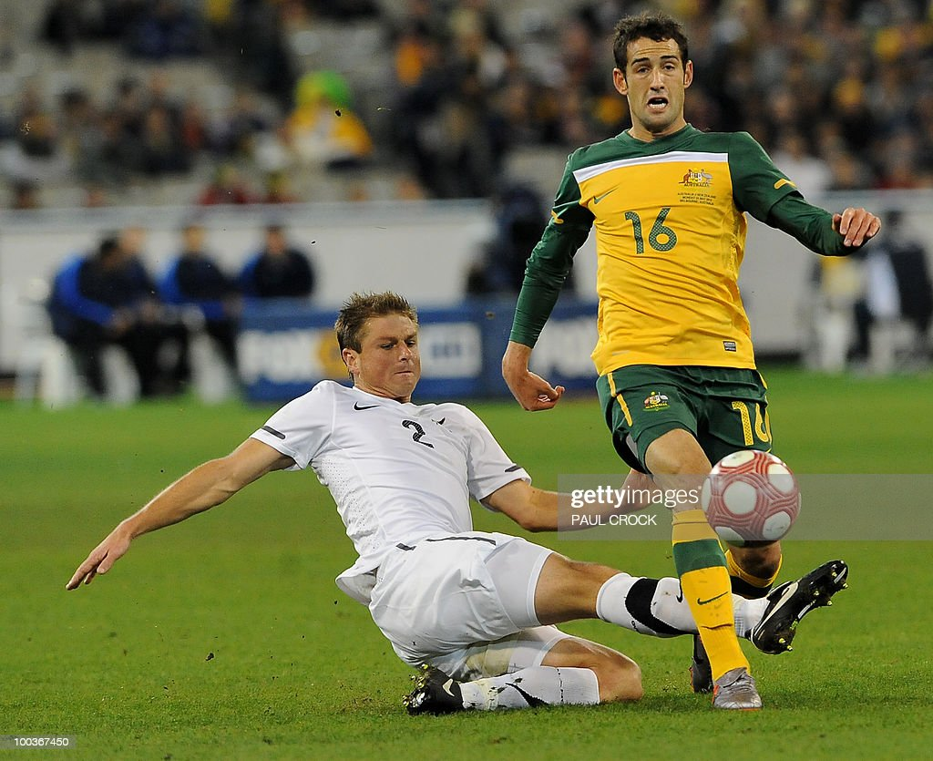 Ben Sigmund of New Zealand (L) tries a sliding tackle on Carl Valeri of Australia during their friendly international football match in Melbourne on May 24, 2010. Australia won the match 2-1. RESTRICTED