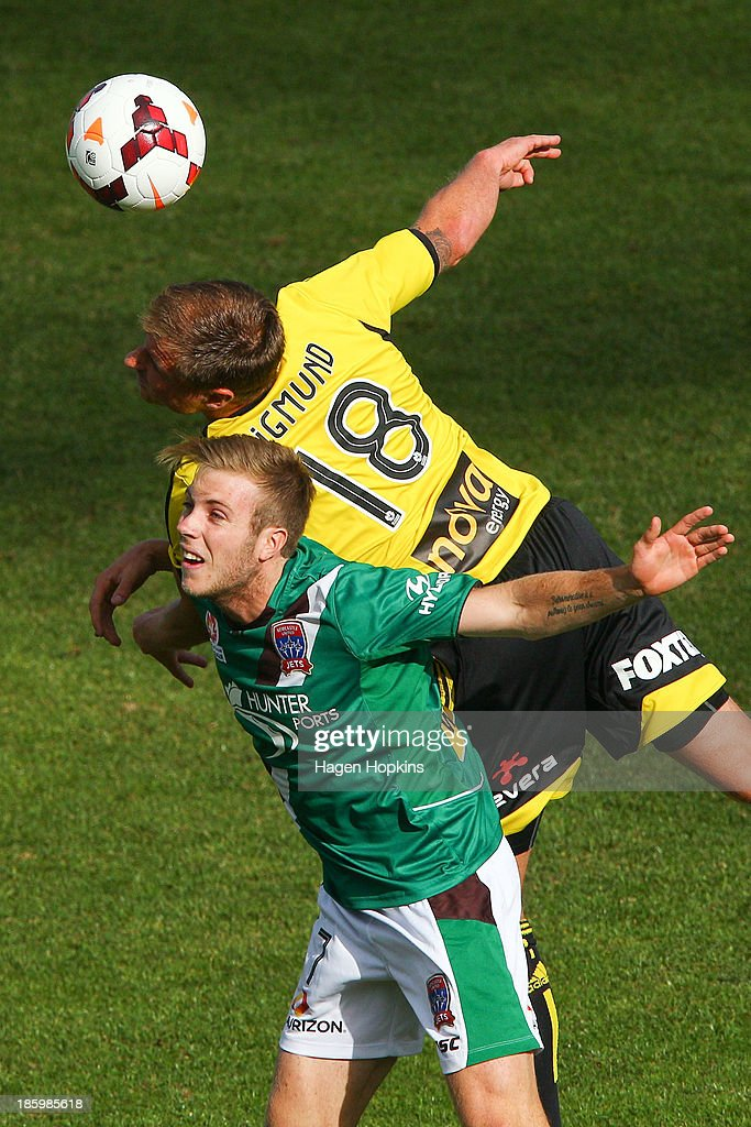 Ben Sigmund of the Phoenix and Andrew Hoole of the Jets compete for a header during the round three A-League match between Wellington Phoenix and the Newcastle Jets at McLean Park on October 27, 2013 in Napier, New Zealand.