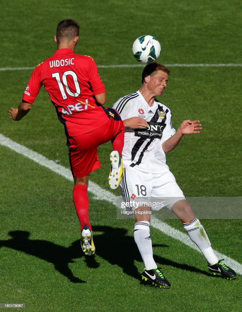 Ben Sigmund of the Phoenix and Dario Vidosic of Adelaide compete for the ball during the round 22 A-League match between the Wellington Phoenix and Adelaide United at Westpac Stadium on February 24, 2013 in Wellington, New Zealand.