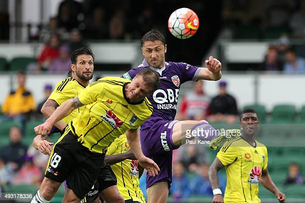 Ben Sigmund of the Phoenix and Dino Djulbic of the Glory contest a corner kick during the round two ALeague match between the Perth Glory and...