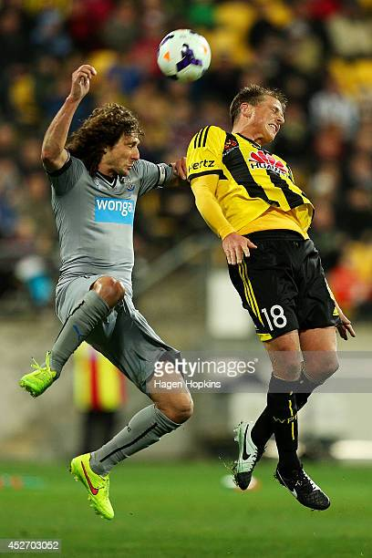 Ben Sigmund of the Phoenix and Fabricio Coloccini of Newcastle United compete for a header during the Football United New Zealand Tour 2014 match...