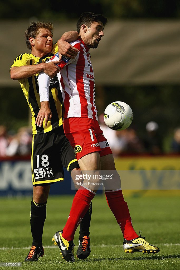 Ben Sigmund of the Phoenix and Jason Hoffman of the Heart contest the ball during the round nine A-League match between the Melbourne Heart and the Wellington Phoenix at Latrobe City Sports & Entertainment Complex on December 4, 2011 in Melbourne, Australia.