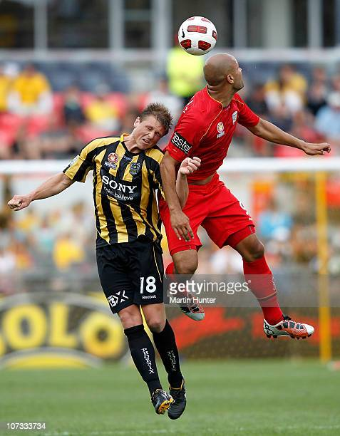 Ben Sigmund of the Phoenix and Sergio van Dijk of Adelaide United contest for the ball during the round 17 ALeague match between the Wellington...