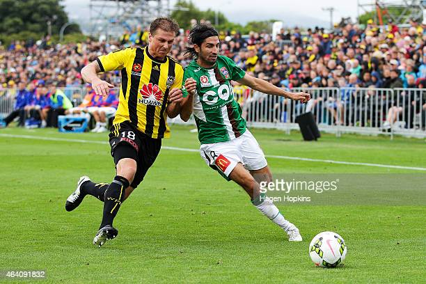 Ben Sigmund of the Phoenix and Zenon Caravella of the Jets compete for the ball during the round 18 ALeague match between Wellington Phoenix and...