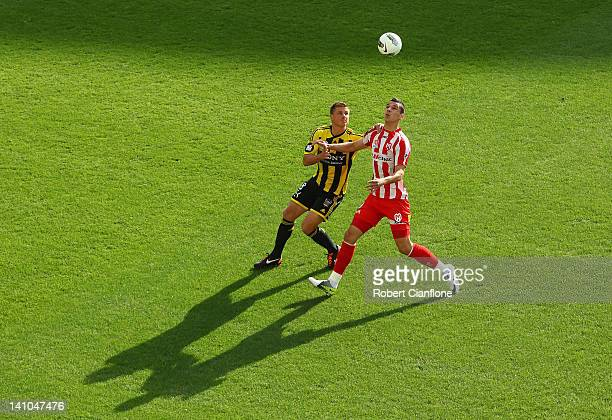 Ben Sigmund of the Phoenix challenges Eli Babalj of the Heart during the round 23 ALeague match between the Melbourne Heart and the Wellington...