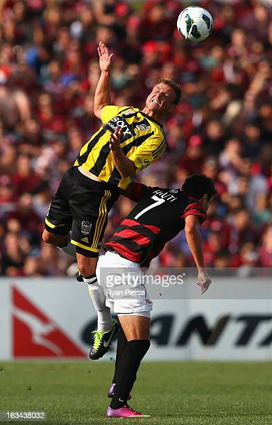 Ben Sigmund of the Phoenix competes for the ball against Labinot Haliti of the Wanderers during the round 24 ALeague match between the Western Sydney...