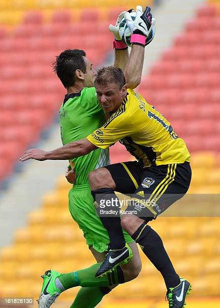 Ben Sigmund of the Phoenix crashes into goal keeper Michael Theo of the Roar during the round 21 ALeague match between the Brisbane Roar and the...