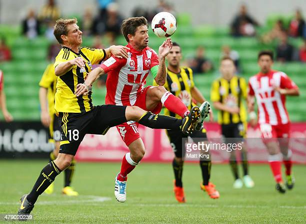 Ben Sigmund of the Phoenix fouls Harry Kewell of the Heart and is subsequently given a red card during the round 23 ALeague match between Melbourne...