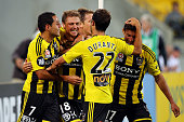 Ben Sigmund of the Phoenix is congratulated on his goal by Leo Bertos Andrew Durante and Vince Lia during the ALeague Elimination Final match between...