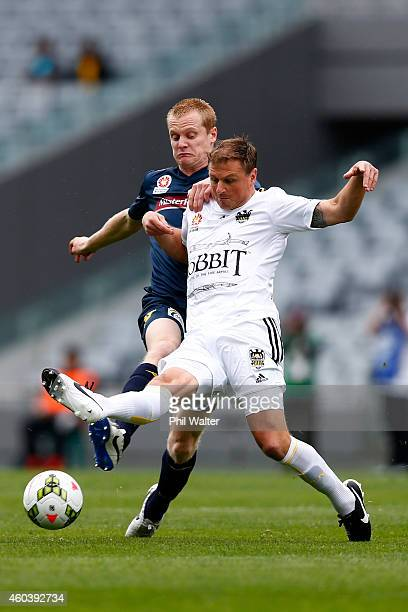 Ben Sigmund of the Phoenix is held by Matthew Simon of the Mariners during the round 11 ALeague match between the Wellington Phoenix and the Central...