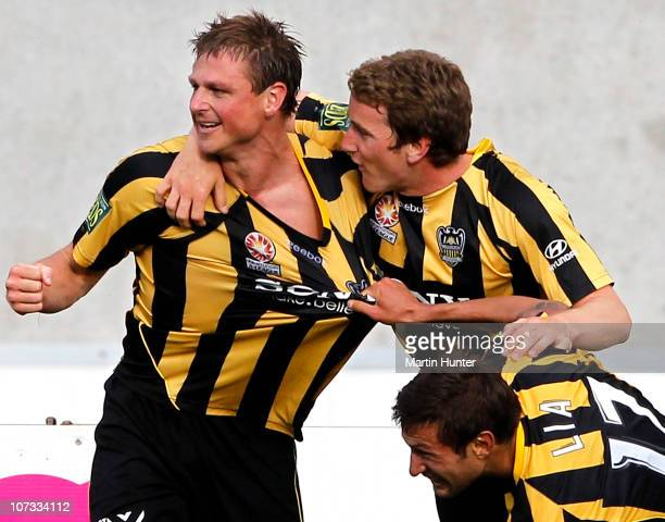 Ben Sigmund of the Phoenix is mobbed by teammates Nick Ward and Vince Lia during the round 17 ALeague match between the Wellington Phoenix and...