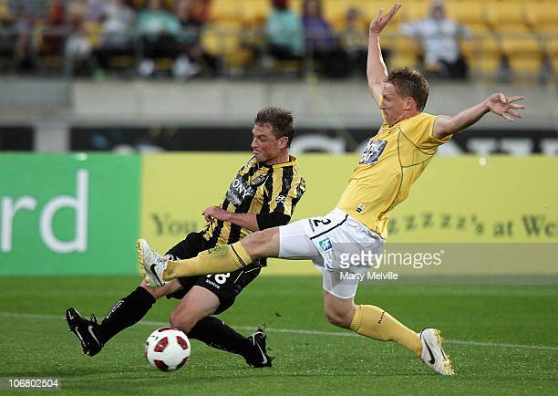Ben Sigmund of the Phoenix is tackled by Daniel McBreen of the Mariners during the round 14 ALeague match between the Wellington Phoenix and the...
