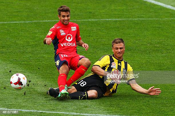 Ben Sigmund of the Phoenix tackles Michael Zullo of Adelaide United during the round 25 ALeague match between Wellington Phoenix and Adelaide United...