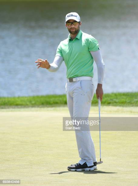 Ben Silverman acknowledges the gallery on the 18th hole during the first round of the Webcom Tour RustOleum Championship at Ivanhoe Club on June 8...