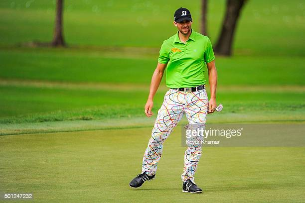 Ben Silverman of Canada reacts to his putt on the ninth hole green of the Champion Course during the final round of Webcom Tour QSchool at PGA...