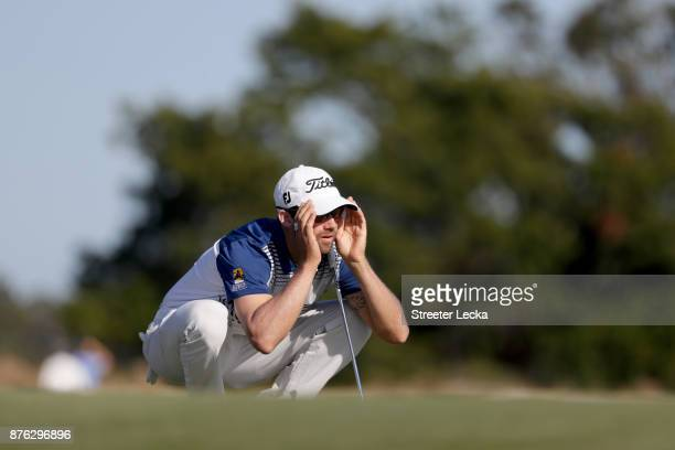 Ben Silverman of the United States lines up a putt on the 13th green during the third round of The RSM Classic at Sea Island Golf Club Seaside Course...