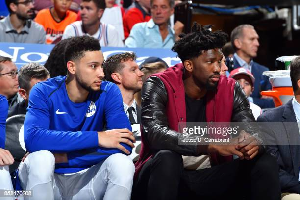 Ben Simmons and Joel Embiid of the Philadelphia 76ers look on during the game against the Boston Celtics during a preseason on October 6 2017 at...