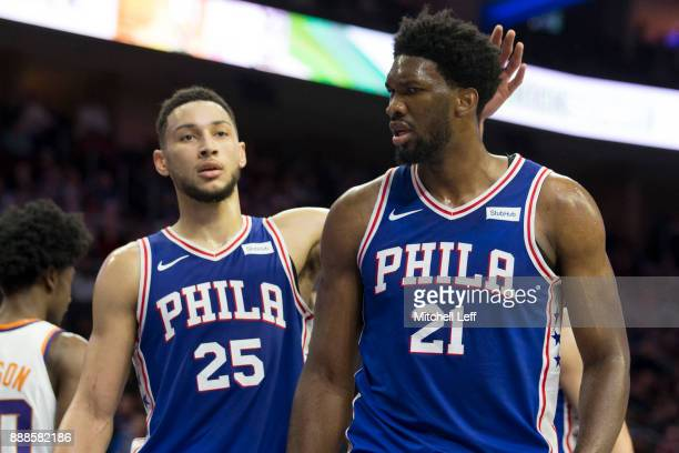 Ben Simmons and Joel Embiid of the Philadelphia 76ers react against the Phoenix Suns at the Wells Fargo Center on December 4 2017 in Philadelphia...