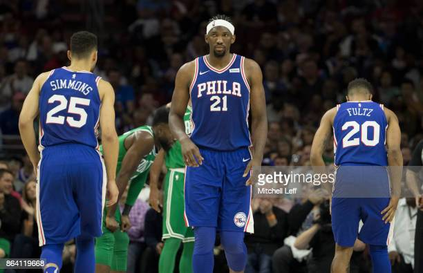 Ben Simmons Joel Embiid and Markelle Fultz of the Philadelphia 76ers play against the Boston Celtics in the first half at the Wells Fargo Center on...