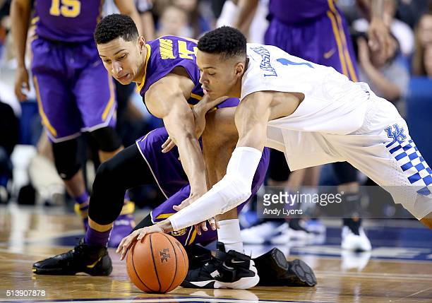 Ben Simmons of the LSU Tigers and Skal Labissiere of the Kentucky Wildcats reach for a loose ball during the game at Rupp Arena on March 5 2016 in...